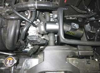 f. Fasten the snorkel to the radiator shroud using the (2) M6 bolts