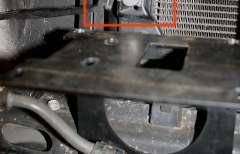 Remove the stock skid plate fastened by 4 bolts (12mm socket) 2 in front and 2 on bottom toward the rear.
