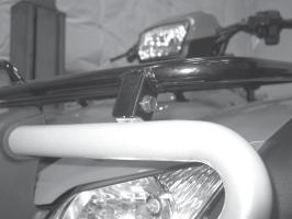 4. the two top 8mm bumper bolts that attach the front bumper to the front rack, figure 4.