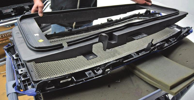 your new T-Rex Grille assembly. Line up the tabs and set it down in place.
