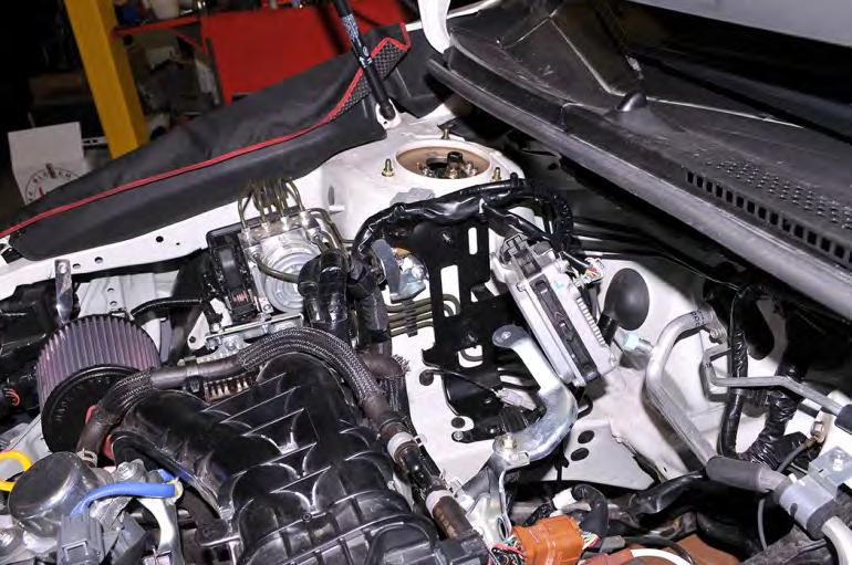 Then pull the ECU free from the bracket and place it aside in the engine