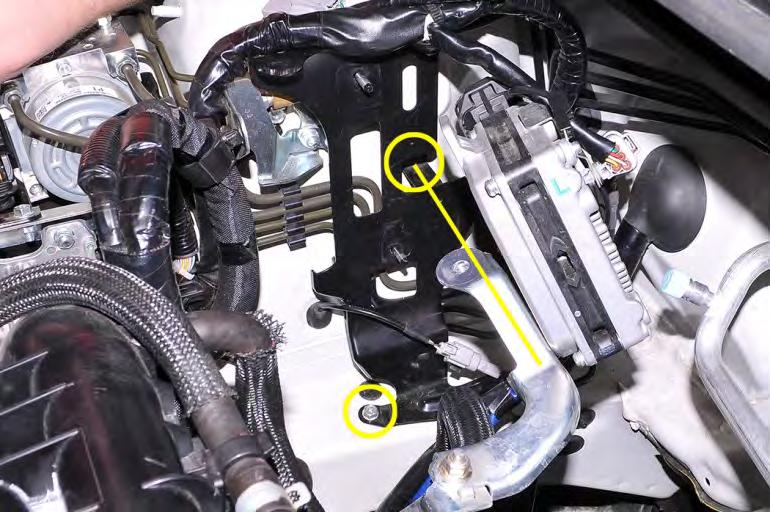 Remove the (2) 10mm bolts that hold the ECU bracket to the passenger side