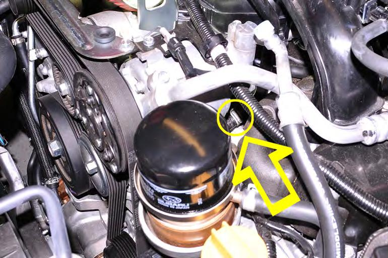 Using hose clamp pliers or needle nose pliers loosen the spring hose clamp on the