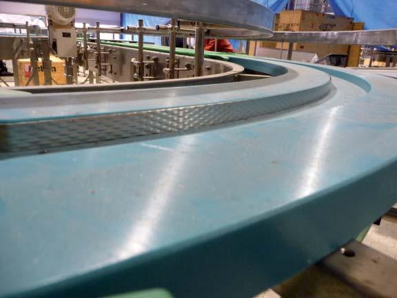 CONVEYOR CONSTRUCTION EXTRA curve: In an EXTRA curve a profiled stainless steel strip is mounted on the inside of the curve.