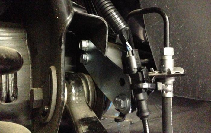 2) Disconnect the brake line bracket at the differential and save the hardware.