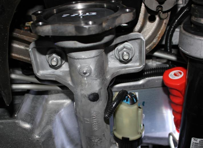 17) Remove differential housing assembly from vehicle.