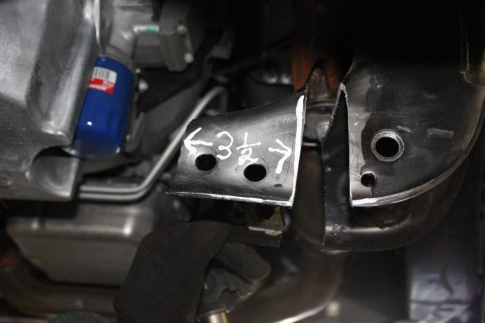 Remove Bolts 18) Locate the rear driver lower control arm mount on the