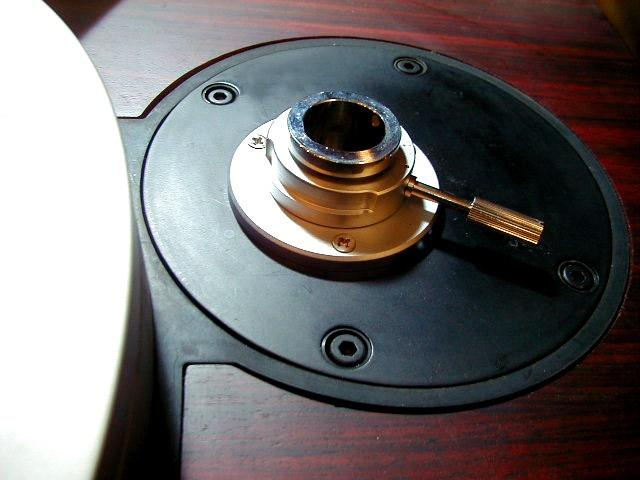 Temporarily place the tonearm into to this hole.