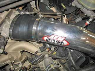 Secure the supplied hose to the valve cover nipple using the