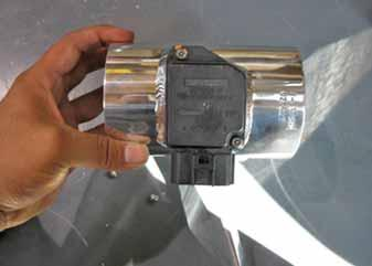 Install the large reducing coupler at the throttle body, and