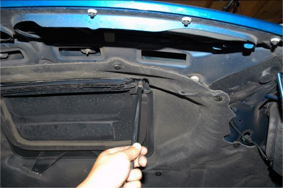 Next, remove the hood scoop liner. DO NOT CLOSE THE HOOD until this is removed.
