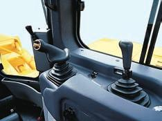 the seat 15 to the right. The transmission and steering controls move with the seat for best operator comfort. The operator seat is also tiltable for facilitating down hill dozing.