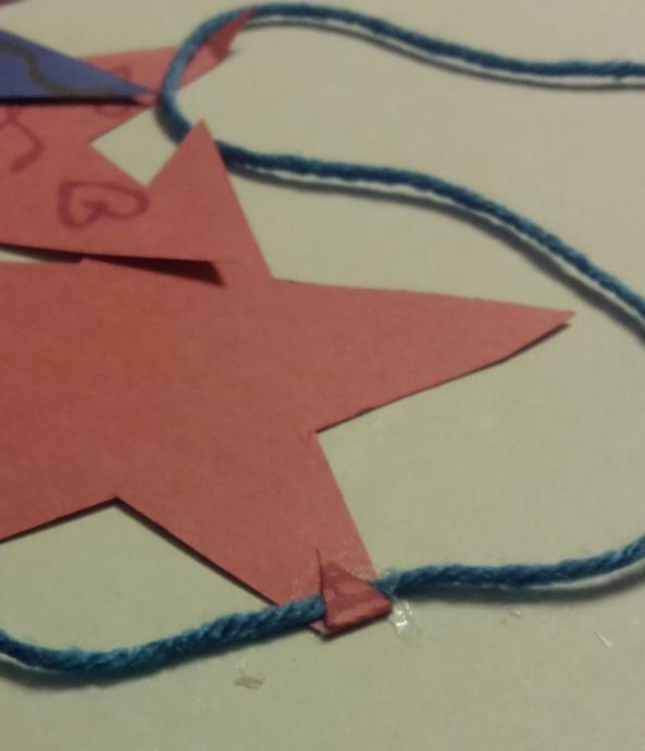 3. Glue the stars to the string by