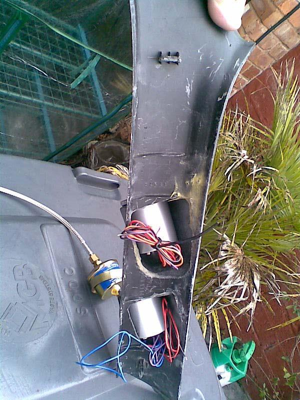 the sandwich plate with bungs in extra ports and oil temp sensor fitted and braided line.