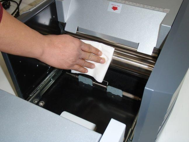 4) Cleaning Press Rollers With general use, toner will build up on the Press rollers.