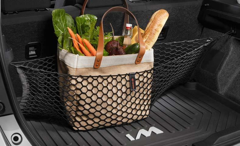 Tote This collapsible, soft-sided cargo tote 3 secures a variety of items, and helps keep them in place.