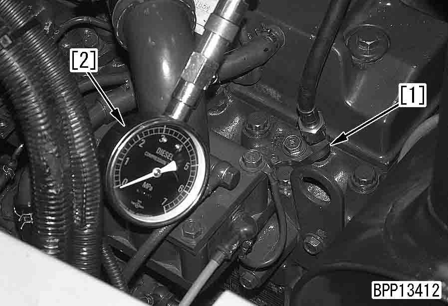 a See Adjusting valve clearance. 2. Warm up the engine until the engine oil temperature is 40 60 C. 6. Remove governor spring (2). 7.