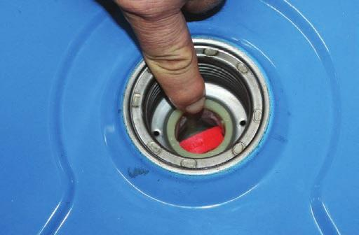 MAINTENANCE 8. Re-install the fuel strainer by hand inside the filling hole on top of the fuel tank (see Figure 39).