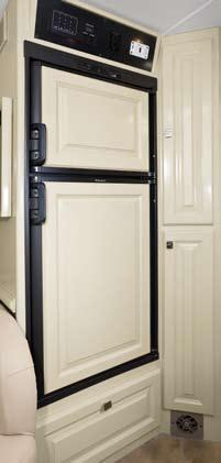 The kitchen is equipped for easy preparation of family favorites: A double door refrigerator keeps perishables