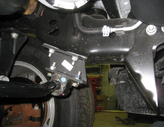 Special note: Re-attach the ABS line clips to the new u-bolts. 47. Locate the new rear shocks.