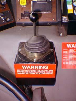 Figure 11. Single Joystick PACKER CONTROLS Three buttons located on the console control the different packer functions. Red Button The red button is an emergency feature.