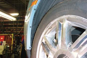 On both sides of the vehicle, use a die grinder to enlarge an existing hole in