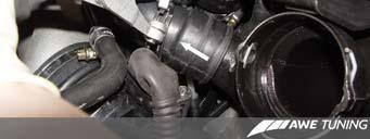 Loosen the bottom hose clamp of the rear diverter
