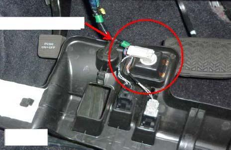 Location of connectors (n) Pull down the driver side under dash trim panel to expose the foot