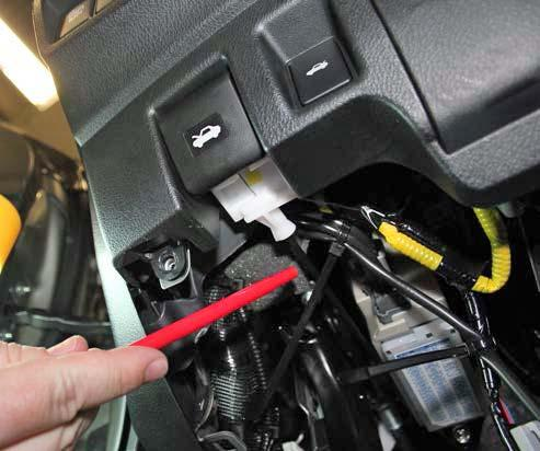 CAUTION: Make sure the wire is routed above the hood latch cable. Do not attach the wire to the hood latch cable. Fig.