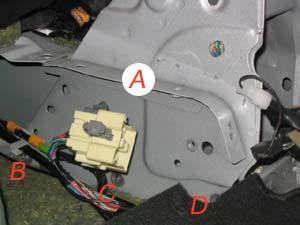 Pull the reel out of the space and place it aside. There are wires attached on the later model cars be careful.