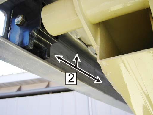 Apply a layer of grease along the inside and top of the upper slide channel (2) on both sides of the machine. Refer to Figure 6-3., Upper Slide Pad Channel. Figure 6-2.