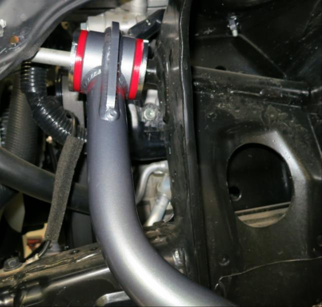 ) Start install of control arm by greasing the bushing face on both sides of the control arms.