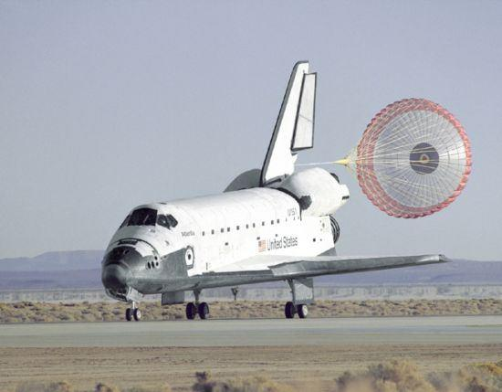 Braking parachute used on the Space Shuttle In addition to brakes and aerodynamic devices, an airplane's engines can also be used to help bring the vehicle to a stop.