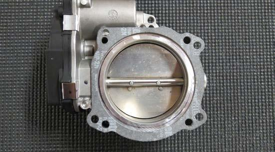 If using the stock 80mm throttle body, use RTV silicone to fill the two (2) holes at the top of the throttle body