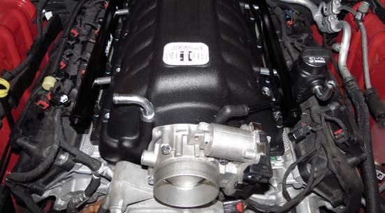 34. Using the provided throttle body gasket and four (4) M6 x 40mm bolts, secure the