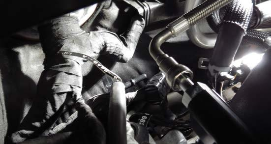 Using a 3/8 fuel line removal tool, remove the factory fuel line from fitting on the