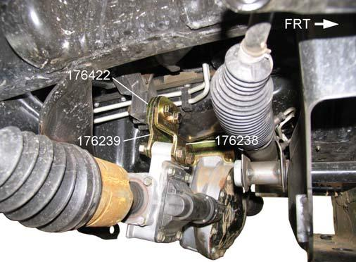 4) Remove the differential housing upper mounting bolts. Carefully lower the differential assembly about 4 inches.