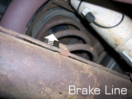 carefull pull the brake line away from the axle