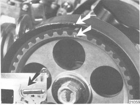 Remove the crankshaft pulley and vibration damper. Remove the belt cover and make a mark on the edge opposite the mark on the camshaft gear. Undo the belt tensioner. Remove the belt. Begin at the tensioner.
