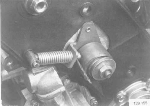 The pistons may strike the valves if the crankshaft or camshaft are rotated when the timing gear belt is removed. Remove the camshaft belt.