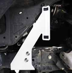 careful to not to damage any brake lines or electrical wires. secure reservoir bracket to vehicle frame. Use the supplied 3/8 self Fig. 3: Driver side sway bar relocation spacer Fig.