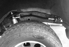 If there is a clearance issue between the sway bar and skid plate braces, install the (4) supplied spacers between the vehicle frame and braces as shown (Fig.