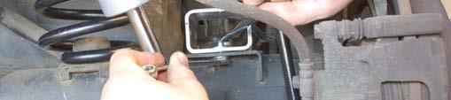 Install spring clip as shown in Photo 63 and secure the caliper end of the brake line with