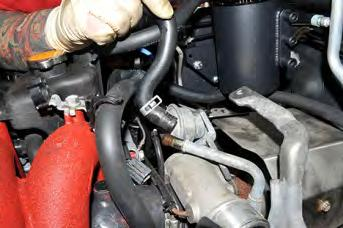 Next, slide the IAG AOS coolant line onto the turbocharger coolant hard pipe and