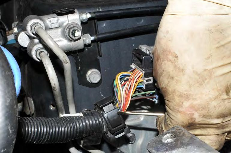 17. * 2007 STI Only - Remove the main engine harness from its mounting bracket located on the passenger side strut tower.