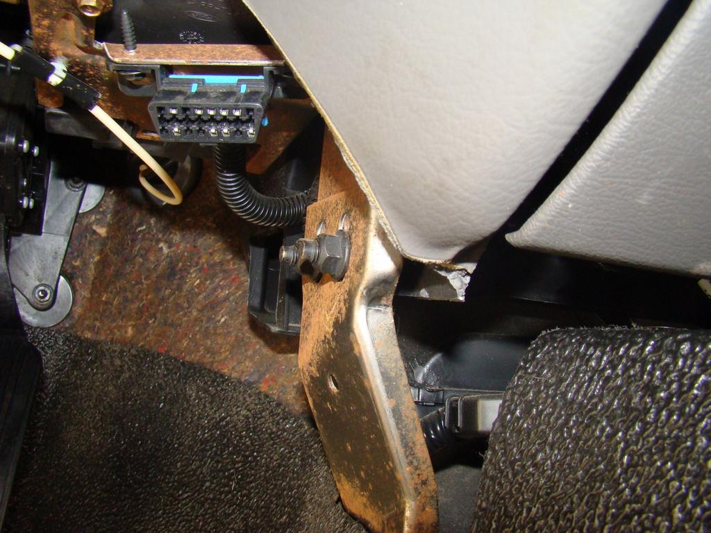 17) On the driver's side center, remove these two nuts and pull the bracket off the studs.