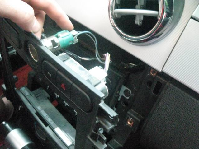 STEP 7: Remove the (6) screws that retain the radio trim plate, using a ¼ nut driver.