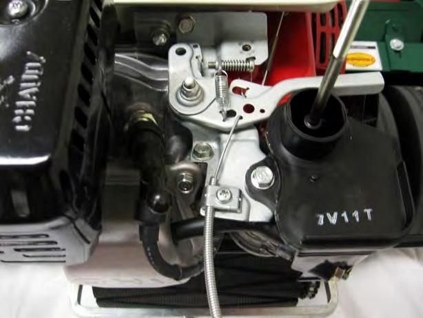 Attach the cable clips to secure the throttle cable to the upper and lower handles.
