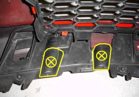 4. Before installing the front bumper you may have to trim the two plastic areas that used to retain the AATS wires with a razor blade or similar cutting device as shown.