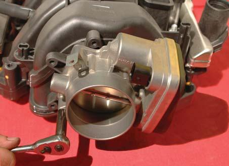 Remove the throttle body using a
